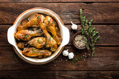 Roasted chicken legs on rustic wooden background, top view Royalty Free Stock Photography