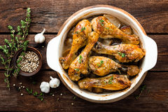 Roasted chicken legs on rustic wooden background, top view Royalty Free Stock Images