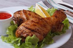 Roasted chicken legs with salad, lemon and ketchup Stock Photography