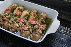 Roasted chicken legs with spices , close-up stock photos