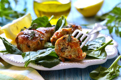 Roasted chicken legs stuffed with carrot and mushrooms. Royalty Free Stock Image