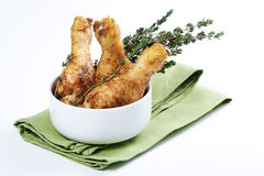 Roasted chicken legs with thyme Stock Photos