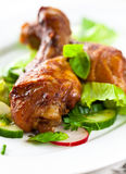 Roasted chicken legs on vegetables Royalty Free Stock Image