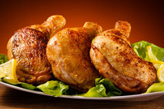 Roasted chicken legs stock images