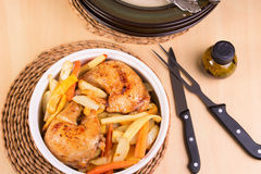 Roasted chicken legs and vegetables in a casserole Royalty Free Stock Photo