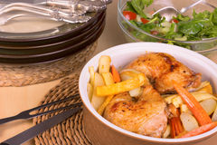 Roasted chicken legs and vegetables in a casserole Royalty Free Stock Photography