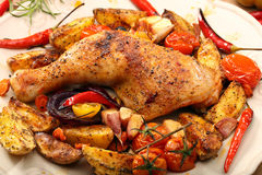 Roasted chicken legs with vegetables and herbs Royalty Free Stock Images