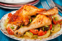 Roasted chicken legs with vegetables Royalty Free Stock Photo