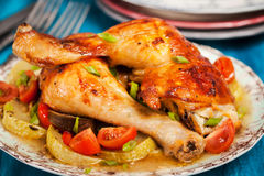 Roasted chicken legs with vegetables Royalty Free Stock Images