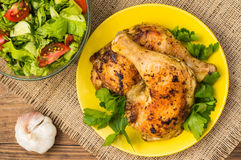 Roasted chicken legs on a wooden background. Top View. Close-up Stock Images