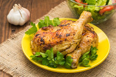 Roasted chicken legs on a wooden background. Top View. Close-up Royalty Free Stock Photos