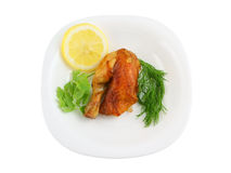 Roasted chicken with lemon and greens on plate Royalty Free Stock Photography