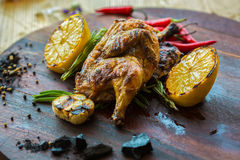 Roasted chicken with lemon and herbs Stock Images