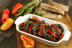 Roasted chicken  liver with fried onion and red  pepper Stock Images