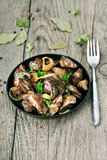 Roasted chicken liver in frying pan Stock Photos