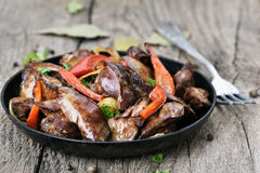 Roasted chicken liver with pepper Stock Photos