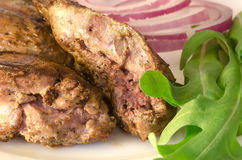 Roasted chicken liver with vegetables Stock Images