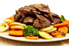 Roasted chicken liver with veggies Stock Images