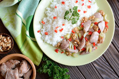 Roasted chicken meat with stalk celery, roasted walnuts and rice Stock Photography
