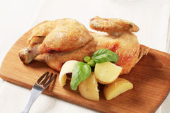Roasted chicken and new potatoes Stock Photo