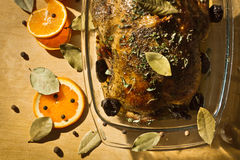 Roasted chicken with orange fruit and dried plums Royalty Free Stock Images