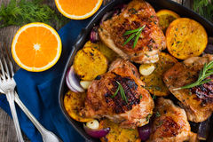 Roasted chicken with oranges and herbs Royalty Free Stock Images