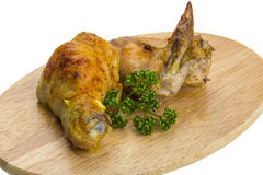Roasted chicken with parsley and carry Stock Photography