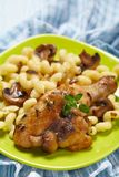 Roasted chicken with pasta Stock Photos
