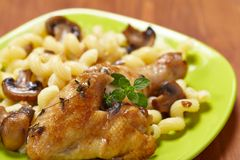 Roasted chicken with pasta Royalty Free Stock Images