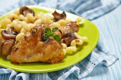 Roasted chicken with pasta Royalty Free Stock Photography