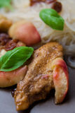 Roasted chicken with peaches and bazil Stock Images
