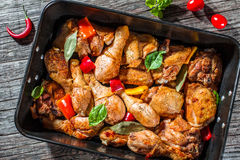Roasted chicken with peppers and herbs, top view royalty free stock photography