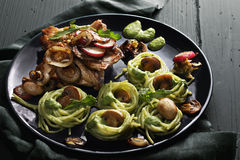 Roasted chicken and pesto pasta Royalty Free Stock Photo