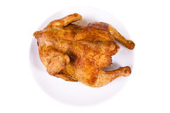 Roasted chicken on plate Stock Photography