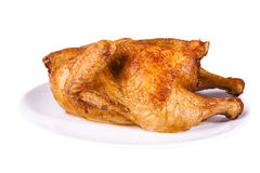 Roasted chicken on plate Royalty Free Stock Photography