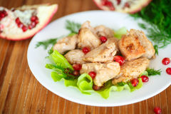 Roasted chicken with pomegranate seeds Royalty Free Stock Images