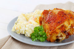 Roasted chicken with potato salad Royalty Free Stock Photo
