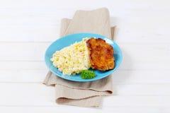 Roasted chicken with potato salad Stock Photos