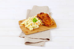 Roasted chicken with potato salad Royalty Free Stock Photos