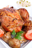 Roasted chicken with potatoes Royalty Free Stock Image