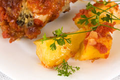 Roasted Chicken And Potatoes Closeup. Food And Drinks - Recipes - Closeup of chicken with potatoes and tomato juice Royalty Free Stock Image