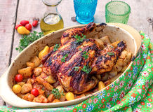 Roasted chicken with potatoes Stock Image
