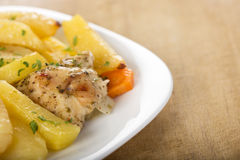 Roasted chicken with potatoes Stock Photography