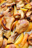 Roasted chicken with potatoes Stock Images
