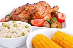 Roasted chicken, potatoes,rice, corn Stock Photo