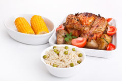 Roasted chicken, potatoes,rice, corn Stock Images