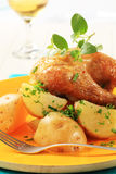 Roasted chicken and potatoes Stock Image