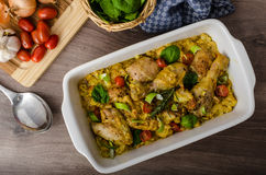 Roasted chicken quarters with curry vegetables Royalty Free Stock Photo