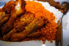 Roasted chicken with red rice turkish styles food cuisines. Roasted chicken leg drum stick with red rice turkish styles food cuisines stock photos
