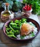Roasted chicken with rice and broccoli, rustic style Stock Image